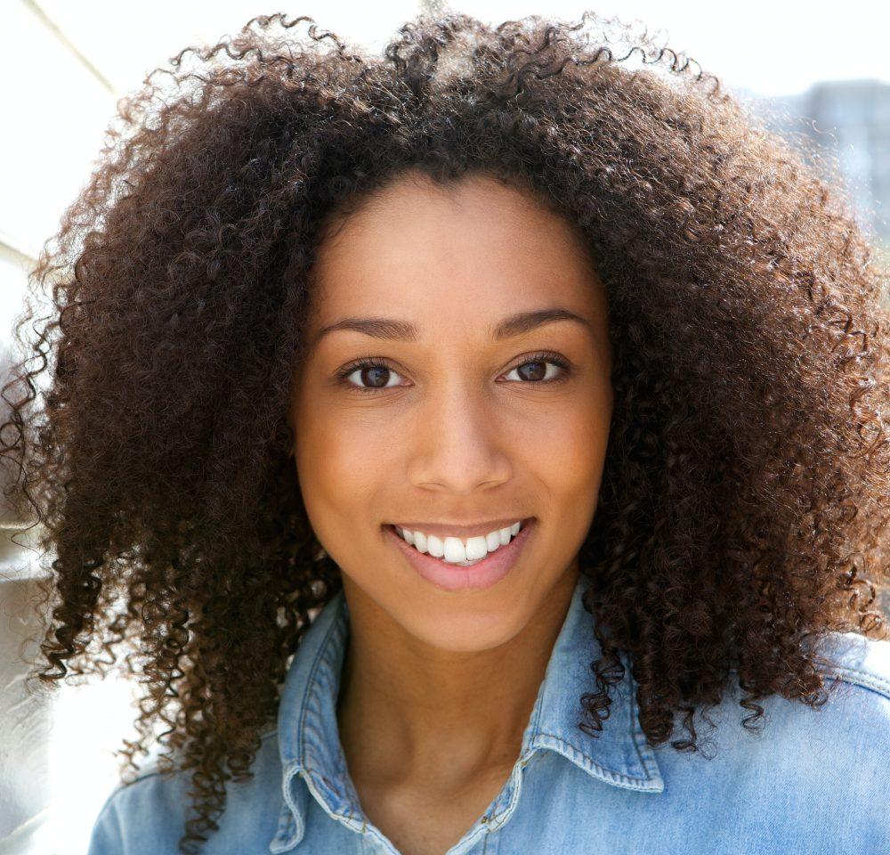 Beautiful young black woman smiling